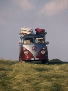 Vw Camper Van with Surf Boards on Roof