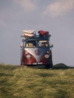 Vw Camper Van with Surf Boards on Roof
