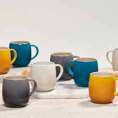 A best-seller this spring, Le Creuset's Heritage Mugs are now available in new fall hues — and they're just right for National Coffee Day. ☕️ Enameled Cast Iron Cookware, National Coffee Day, Keep Food Warm, Kitchenware, Tableware, Deep Teal, Le Creuset, Mugs Set, Hot Chocolate