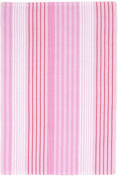 Think pink! Customers requested a versatile pink rug to sink their toes into, so we delivered with this striped woven cotton in shades of rose, pale pink, white, and red.