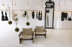 Aje Brisbane retail store designed by Triibe @wearetriibe - with custom made copper clothes rails and string garden.