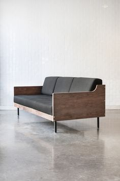 Gus Modern Archive sofa, a sleek box-frame design with a strong mid-dentury influence that features steel legs, exposed brass fittings and removable back cushions to convert sofa into daybed for overnight guests. Inner frame is made of 100% FSC certified hardwood in support of responsible forest management. $2,499, stylegarage.com