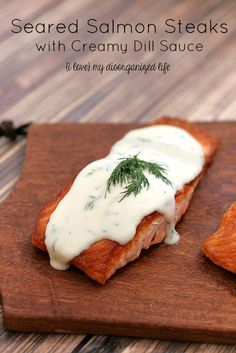 This seared salmon dish is a healthy and flavorful meal that comes together in under an hour and the creamy dill sauce is worth the effort.