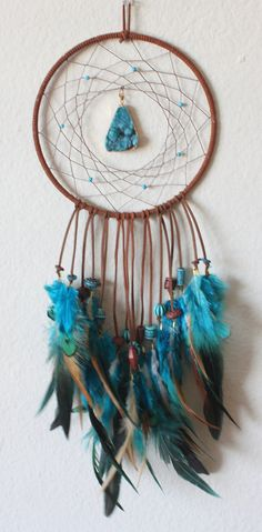 7.25 x 21 Dreamcatcher wrapped in brown faux suede, brown hemp, turquoise howlite beads, turquoise agate druzy pendant, rustic brown and