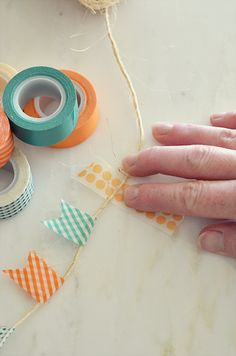 Washi tape banner on jute or bakers twine. This can also be a great idea on a larger scale with design/pattern paper.