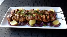 Yogurt, lemon, and spices combine to make a rich and creamy marinade that coats Chef John's grilled lamb skewers. Serve with flatbread or rice and cilantro chutney.