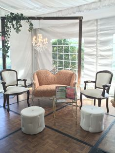 Hyatt Regency Mission Bay- Pavilion Tent. Vintage, Garden Chic Lounge from Lauren Sharon Design & Rentals.  Featuring our coral loveseat, white linen Louis chairs, linen upholstered ottomans and wood arbor with crystal chandelier. The perfect wedding decor and furniture rental for your big day!