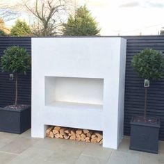 Addition of a loft conversion, rear extension with bi folding doors and a contemporary garden by is and ren studios ltd Contemporary Outdoor Fireplaces, Modern Outdoor Fireplace, Outdoor Fireplace Designs, Backyard Fireplace, Contemporary Garden, Outdoor Rooms, Outdoor Living, Outdoor Gardens, Raised Flower Beds