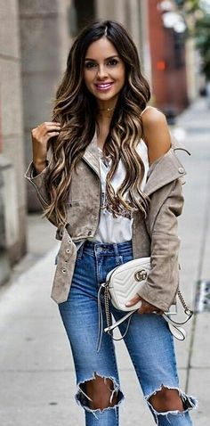 #fall #outfits women's white spaghetti strap V-neck top, distressed blue jeans, and brown parka coat