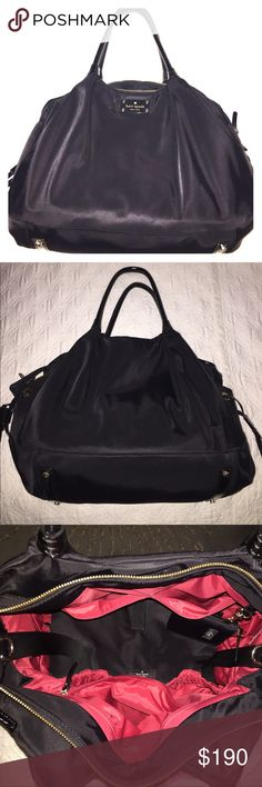 Kate Spade Stevie Diaper Bag This bag has been used only a few times! It is in excellent condition/new condition. Black exterior with red lining. kate spade Bags