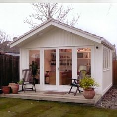 BOOKWORMS WILL LOVE THIS SHE SHED LIBRARY.