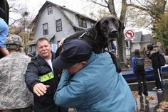 A resident and his dog are removed from the neighborhood Little Ferry, New Jersey. Photo: Getty Images / Andrew Burton