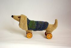 stuffed dachshund / wiener / sausage dog / doxie on wooden button wheels with crochet dog coat for home decor