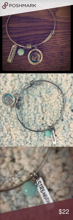 "BOGO50%✅ NWOT NEVER WORN This bracelet has never been worn but is simple and sweet! It has 3 charms: an anchor in closed in aquamarine colored beads, a light blue round bead, and has ""strength"" engraved on another charm. This bracelet would make a great gift! It fits similarly to a bangle but is NOT noisy or uncomfortably loose and is cute for casual wear. Francesca's Collections Jewelry Bracelets"