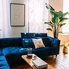 """Why did @alinatsvor choose our Ms. Chesterfield sofa in Oxford Blue Mod Velvet? """"Really, I'm just making all my Pinterest dreams come true."""" Read more about Alina and her stylish space at the link in bio."""