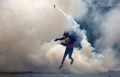 An opposition supporter clashes with riot police during a rally against President Nicolas Maduro in Caracas, Venezuela. REUTERS/Carlos Garcia Rawlins