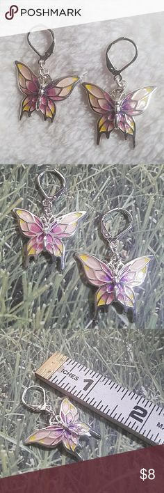 "Silver Butterflies in Flight Simple Dangle Earring These beautiful butterflies are set in silver w/lockback style closure and have shades of pink, purple, & Yellow to accent it's wings. Measuring at about 1.5"" long and 1"" wide. Item#E540 ALL JEWELRY IS NWT/NWOT/UNUSED VINTAGE  **25% OFF BUNDLES OF 3 OR MORE ITEMS** *BUY MORE & SAVE SPECIALS ALWAYS GOING ON!* REASONABLE OFFERS ACCEPTED.  PRICE FIRM UNDER $10 WITHOUT BUNDLING! BUY WITH CONFIDENCE~TOP SELLER, FAST SHIPPER, 5 STAR RATING! Jesi's…"