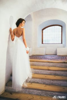 Soft tulle wedding dress made by Pukuni (www.pukuni.fi). Open back, straps, bow, bride, castle, Turku, Finland.