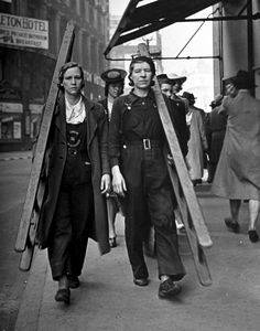 two window cleaners striding towards the next job in central London, 1941.