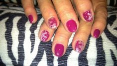 Winter nail design!  Acrylic nails with stamped snowflake nail art and gel top coat.