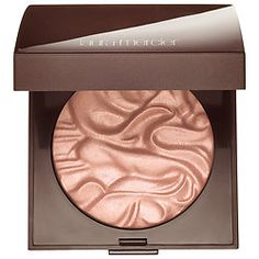 Laura Mercier - Face Illuminator Powder  in Devotion. A cool light pink highlight that is perfect for pale skin.