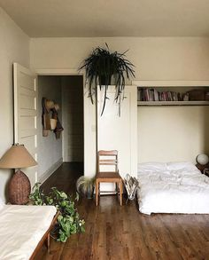 Simple Bedroom Hard wood floors hanging plants and white bedsheets make for a r - Floor Plants - Ideas of Floor Plants - Simple Bedroom Hard wood floors hanging plants and white bedsheets make for a relaxing environment Bedroom Apartment, Apartment Living, Apartment Plants, Studio Apartment, Living Room, Apartment Ideas, Bedroom Plants, Bedroom Decor, Bedroom Inspo