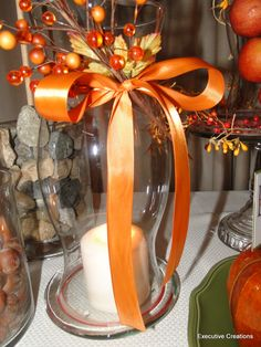 diy fall hurricane vase | Dress up hurricane lamps and vases with ribbons and floral picks.
