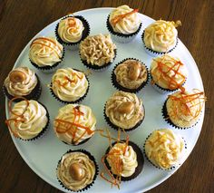 Chocolate cupcakes with a caramel filling and topped with a creamy caramel buttercream and homemade caramel rounds or a caramel candy.