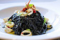 La Tavola's BLACK LINGUINE squid ink pasta, calamari, Calabrian chilies, Thai basil pest    http://latavolatrattoria.com