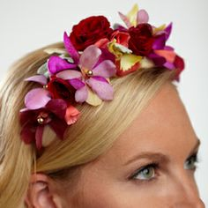 The FTD® Bridal Best™ Hair Décor will give you an ethereal glow on your wedding day. Gold cymbidium orchids, coral roses, red spray roses, lavender vanda orchids, red vanda orchids, and dusty miller stems are arranged beautifully and secured to a headband to create a dramatic and colorful look.  US $74.99  Add US $2.95 service fee per order Add 8.4% tax