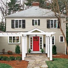 pretty front porch pergola, gray house with red door