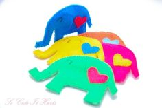 Aaahhh!!  Cuteness overload!  Colorful elephant shaped coasters!