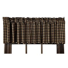 Black Check Valance, by Nancy's Nook. The Black Check Collection features a classic primitive checked pattern of <strong>Black and TAN</strong>. This is for the Valance. Lightly lined, with a scalloped edge. Measures 72 inches wide with a 16 inch drop. Measurements includes 3.25 inch rod pocket and 2 inch header. 100% cotton. Lined. Other matching linens al...