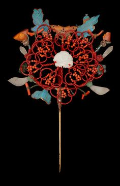 Assorted hair pins. Kingfisher inlay done in floral and insect sprays with various semi-precious stones and silk thread. One hair pin looks to be cinnabar with Kingfisher inlay. Mid to late Qing Dynasty.
