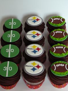 By patisseriejaja via Cake Central: Football Steelers cupcakes - Chocolate cupcakes with chocolate ganache. Decorations are fondant.