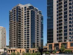 For a showing contact Dechi Lu at 425.358.0366. Luxury, downtown Bellevue living in this 2 bedroom, 2 bathroom, West facing condo with den.  Large balcony is perfect for entertaining and enjoying the city view.  Great location, close to shopping, fine dining and entertainment.  Stainless steel Kitchen Aid appliances, granite counter tops, hardwood floors built-in home entertainment system w/ speakers in every room & security system.