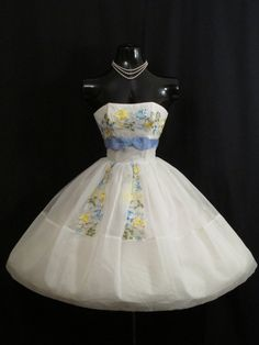 Description  An absolutely adorable original 1950's strapless dress in an ethereal white chiffon organza decorated in glorious baby blue, primrose