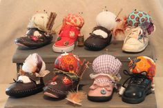 Old baby shoe pin cushions!