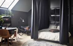 You can use IKEA products to make a cocoon bed. Install a track rail system on the ceiling around a bed frame, like KOPPARDAL in grey, powder-coated steel. Hang curtains like SANELA in dark blue cotton velvet that help block light and dampen noise.
