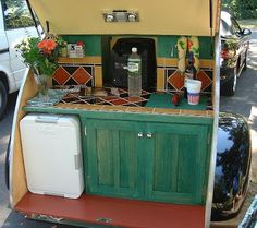 This galley utilizes a plug in fridge, no ice to buy or water to drain.