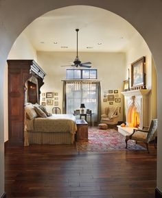 A Master Suite in a Warm, Mexican Style  The room is framed by an elegantly arched entryway