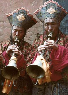 Tibetan Monks Playing Ceremonial Gyalings (Horns)