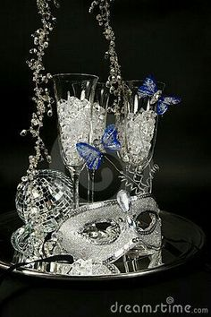 Silver center piece with ornament, mask krystals in champagne glasses Mirror base.