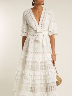 Zimmermann gives artful form to romantic ruffles with this ivory cotton-batiste Corsail dress from the Resort 2018 collection. It's shaped with a V-neckline, elbow-length sleeves, an optional belt, and tiers from waist to hem – adorned throughout with pintucks and guipure-lace inserts. Frame it with substantial earrings and raffia flatform sandals.