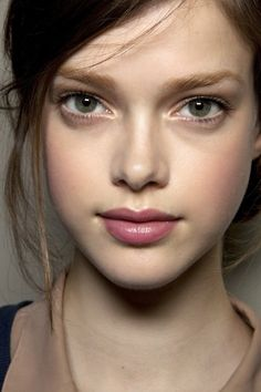 Flushed cheeks and a hint of pink on the lips allow her glowing skin to shine