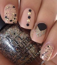Amazing nude and black polish combination. With the help of black and gold sequins, beads and glitter, the nail art looks absolutely ravishing.