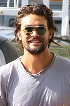 Jason Momoa Look at that adorable cheeky smile , what a rogue :D  What a HUNK :P!