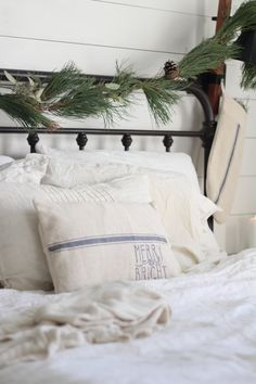 Thank you so much for stopping by our little farmhouse to see it all decked  out for Christmas. I decided to keep it very simple this year, with fresh  greenery, grain sack, candles and knit pillows and blankets.  Welcome to  our Farmhouse on Boone.  I am so glad you're here.