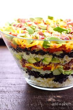 Mexican Cornbread Salad makes a delicious layered salad recipe using buttermilk cornbread, beans, tomatoes, and so much more! // addapinch.com
