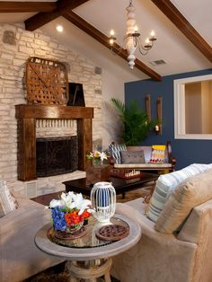 The Property Brothers updated the living room with a open-concept design. Exposed wood beams and stacked stone fireplace bring in a rustic element, while furniture in neutral shades create a comfortable seating area.